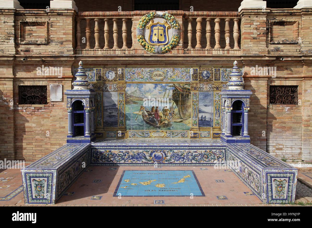 Ceramic Azulejos tiled provincial Bench or Alcove of Canarias  on the Plaza de España in Parque de Maria Luisa - Stock Image