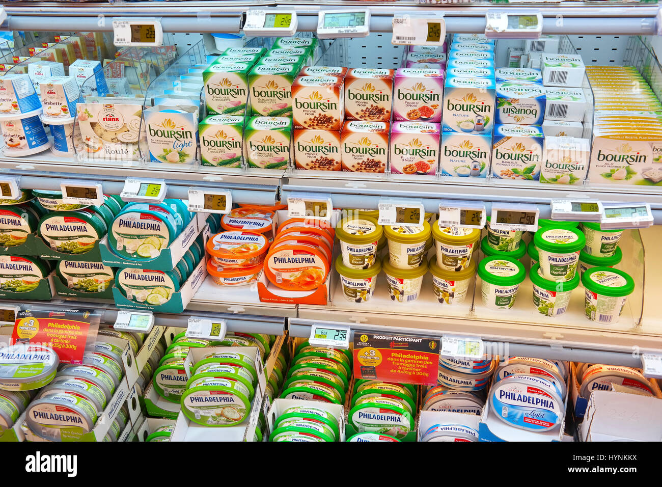 Various packings of Cream cheese in a store - Stock Image