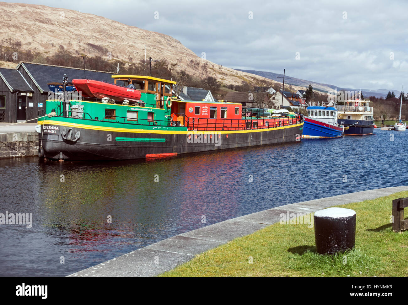 Barge Ros Crana moored in the Caledonian Canal basin at Banavie near Fort William in Highland Scotland UK - Stock Image