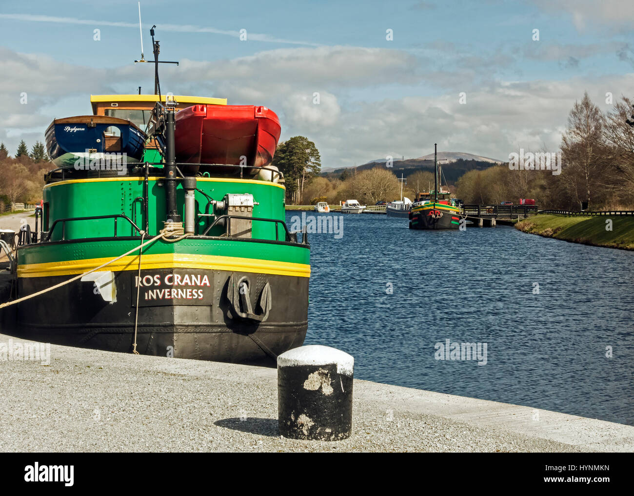Barges Ros Crana and Fingal moored in the Caledonian Canal basin at Banavie near Fort William in Highland Scotland - Stock Image
