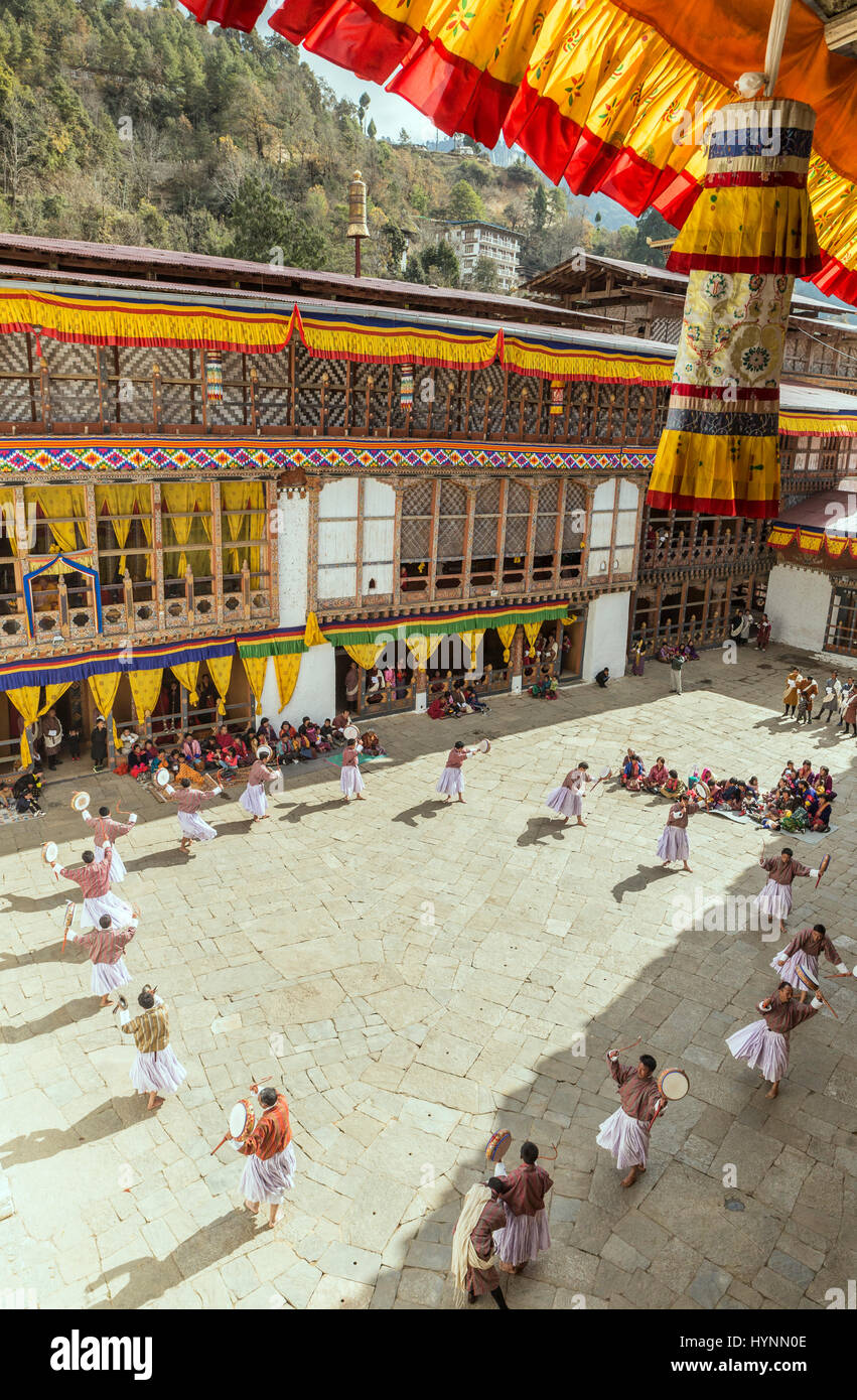 Traditional dancing during the annual Tshechu festival in Bhutan - Stock Image