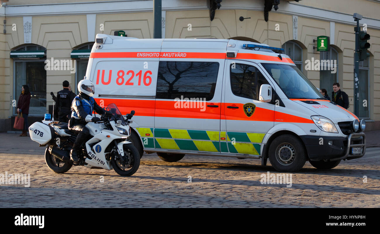 Helsinki, Finland. 5th April, 2017. Motorcycle policeman and intensive care ambulance secure the safety of President - Stock Image