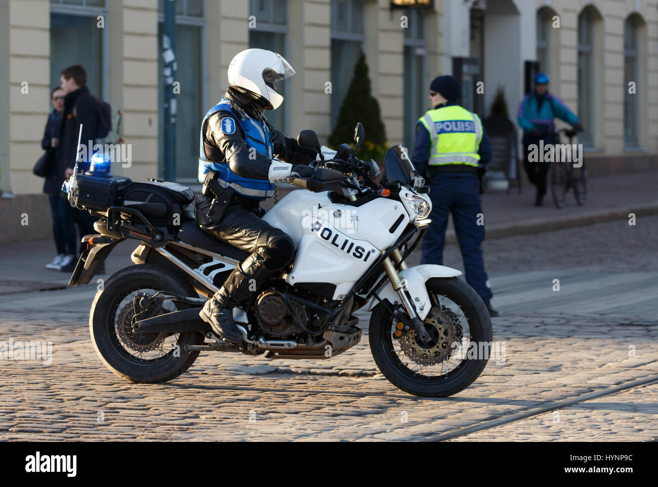 Helsinki, Finland. 5th April, 2017. Motorcycle policeman secures the safety of President Xi Jinping Credit: Hannu - Stock Image