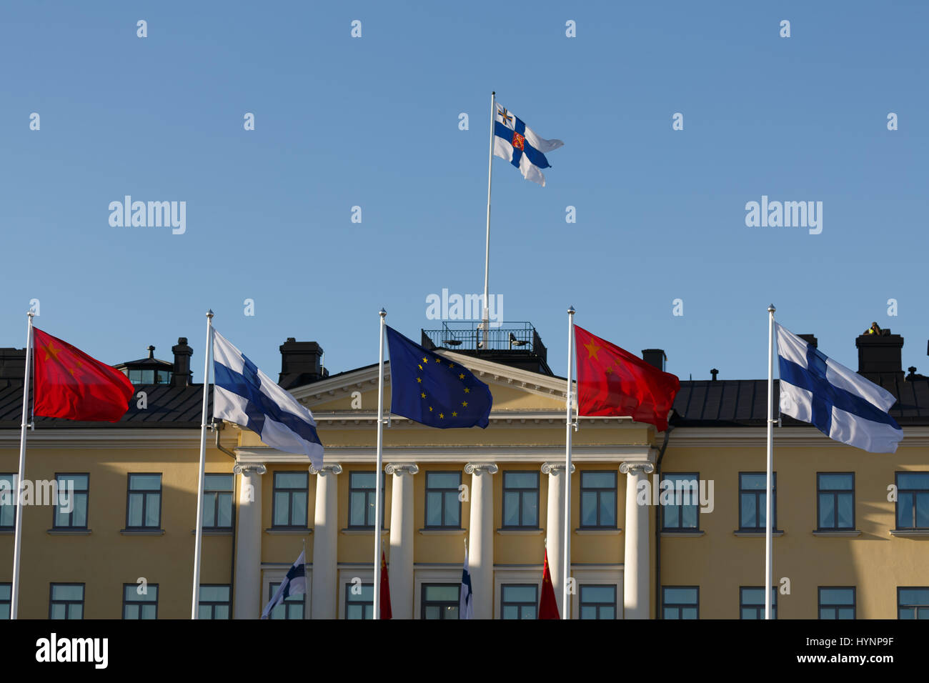Helsinki, Finland. 5th April, 2017. Flags of China, Finland and the EU decorate the Presidential Palace in Helsinki Stock Photo