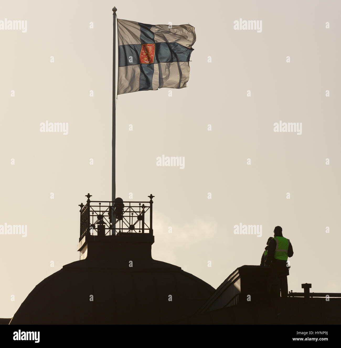 Helsinki, Finland. 5th April, 2017. Police observer on a rooftop works for the security arrangements in Helsinki Stock Photo