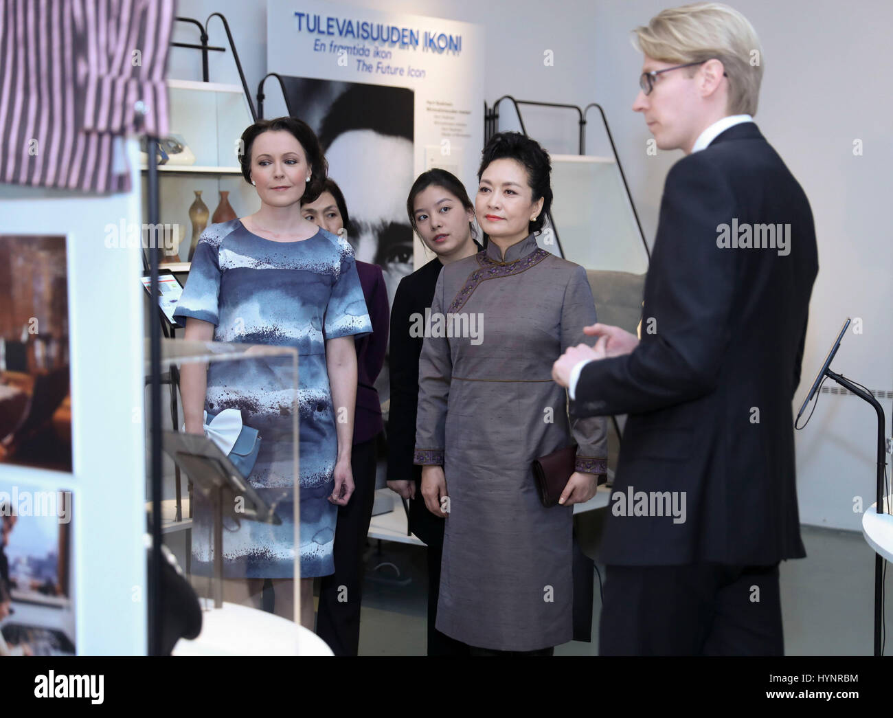Helsinki, Finland. 5th Apr, 2017. Peng Liyuan (2nd R), wife of Chinese President Xi Jinping, visits the Design Museum Stock Photo