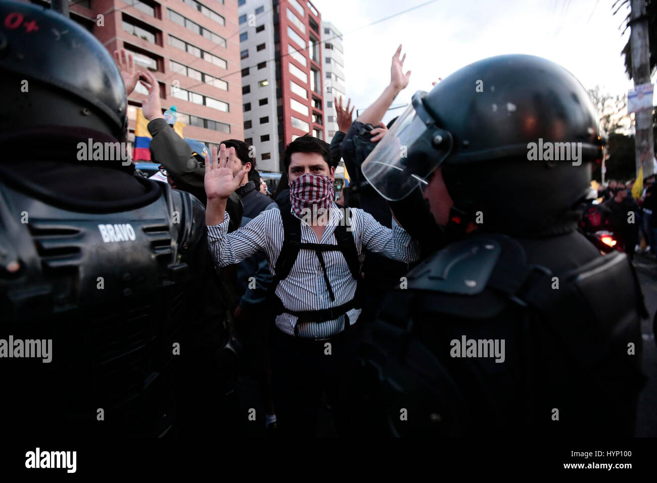 Quito, Ecuador. 06th Apr, 2017. A demonstrator shouts slogans during a protest against Ecuadorian presidential electoral - Stock Image