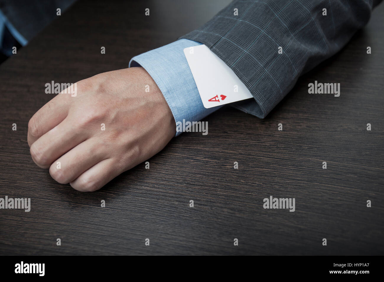 Man's hands close up, hide an ace in a sleeve - Stock Image