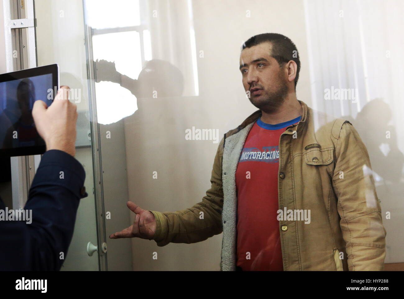 St Petersburg, Russia. 6th Apr, 2017. Kyrgyz-born Atabek Rustamov detained on suspicion in recruiting for the Islamic - Stock Image