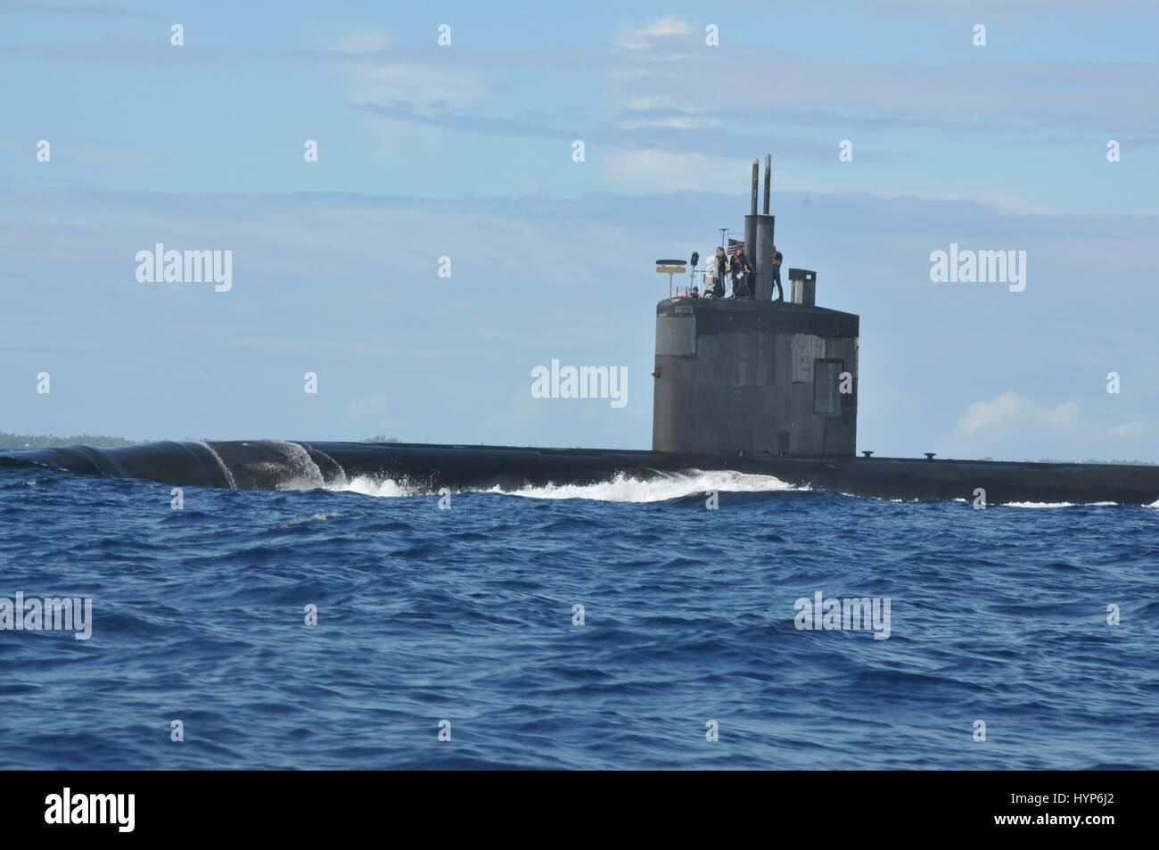 The U.S. Navy Los Angeles-class fast-attack submarine USS Pasadena surfaces as it steams underway March 13, 2017 - Stock Image