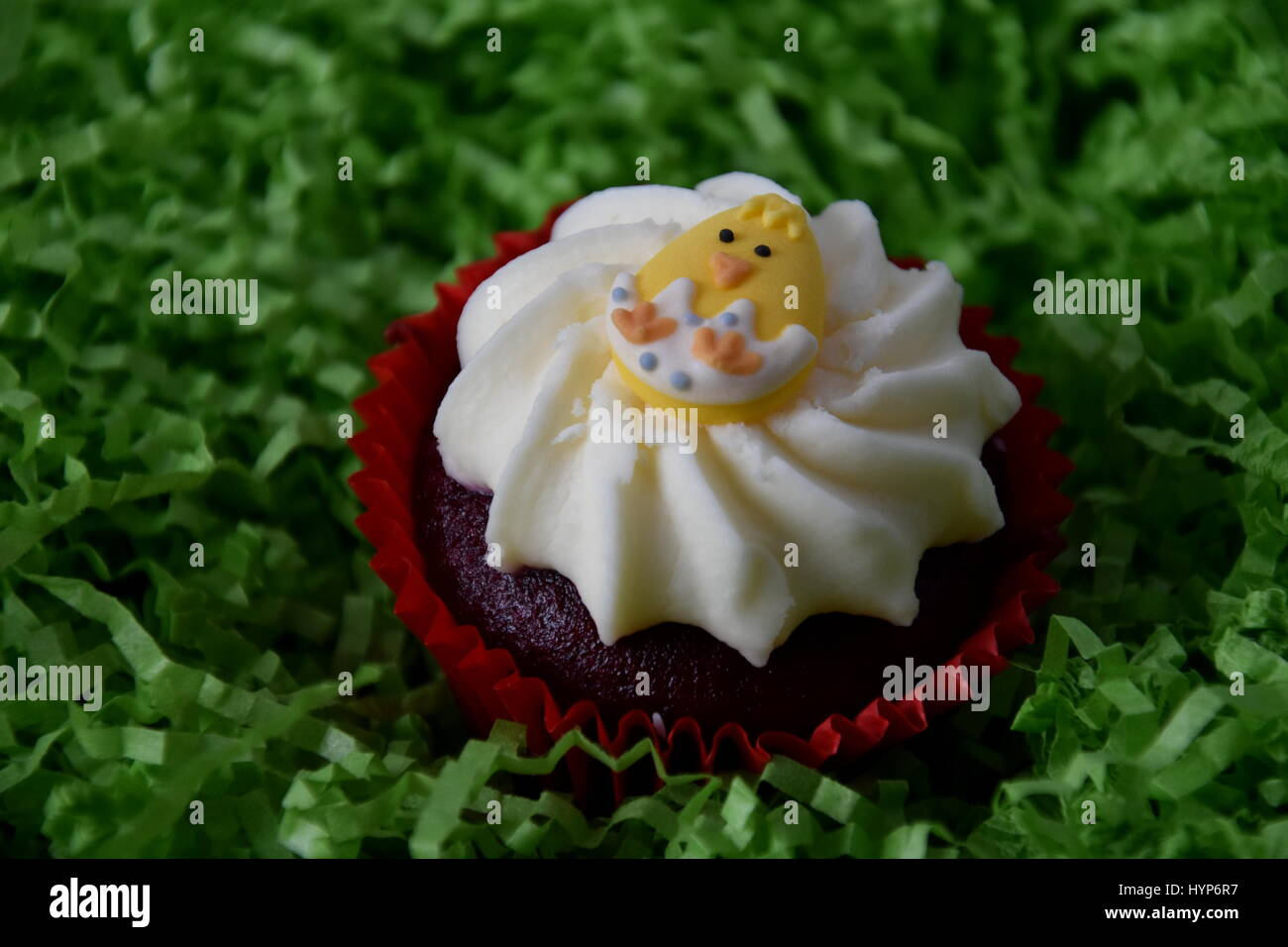 Home Made Easter Muffin Decorated With Egg Concept Yellow Chicken On Top Of The Red And White Cupcake In Green Nest