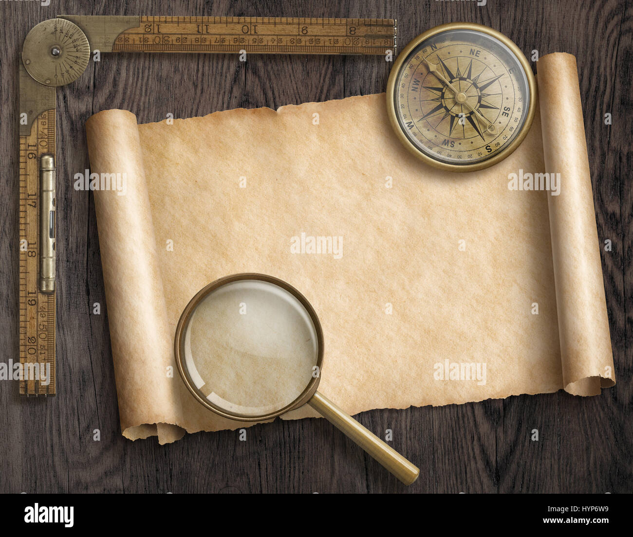 Antique Scroll Map: Vintage Nautical Compass And Loupe On Table With Treasure