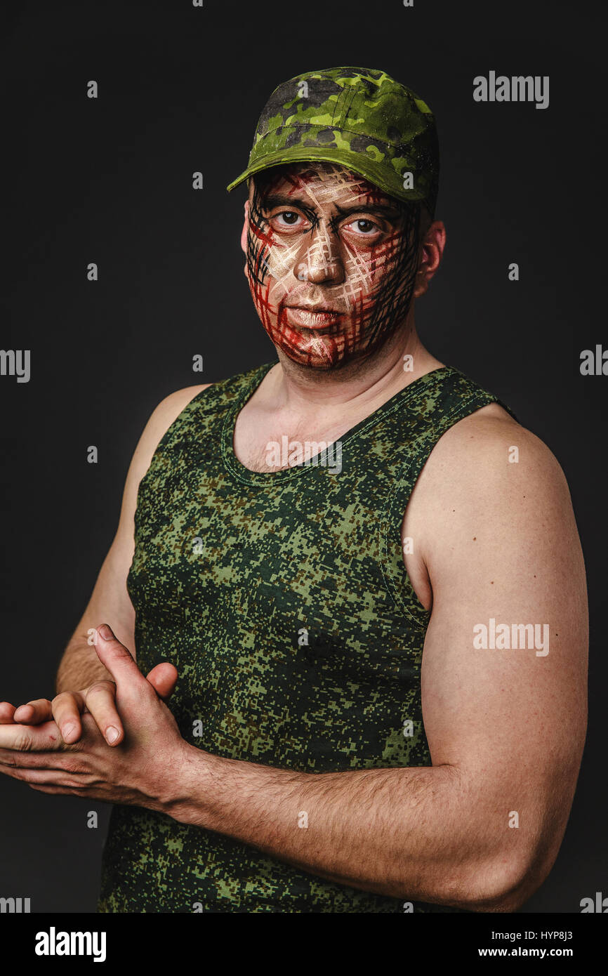 Portrait Of Brutal Man With Creative Military Style Camouflage Face