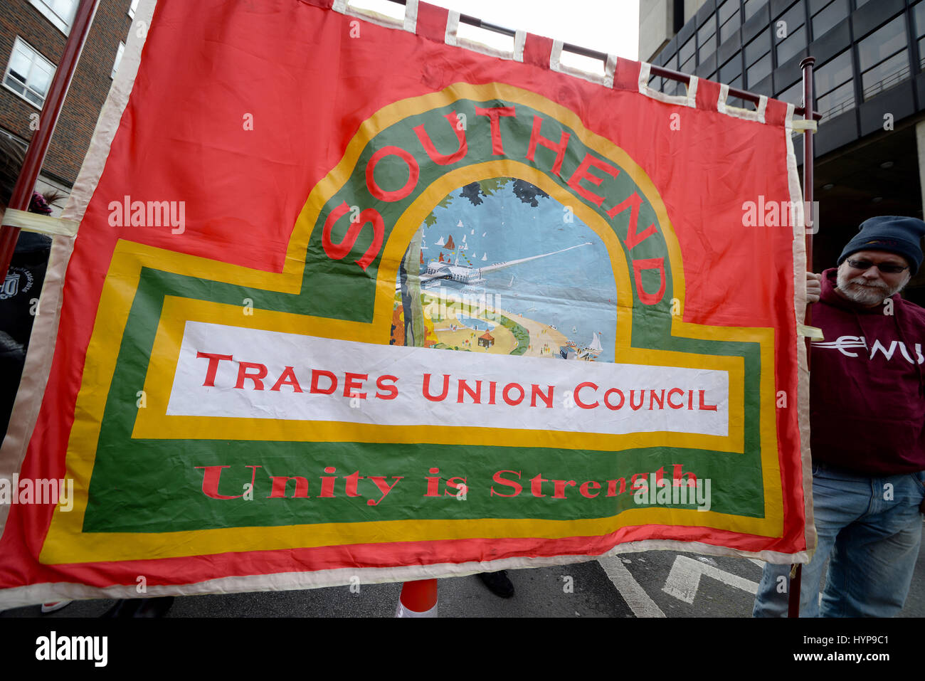 Southend Trades Union Council banner stating Unity is Strength during a support for the NHS demonstration in London - Stock Image