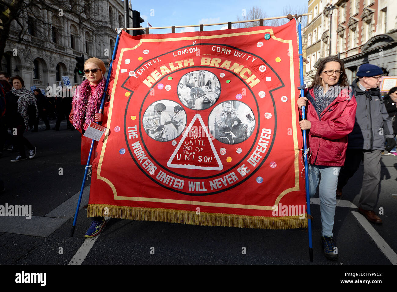 Central London Community Health Branch banner with the slogan The Workers United Will Never Be Defeated during NHS - Stock Image