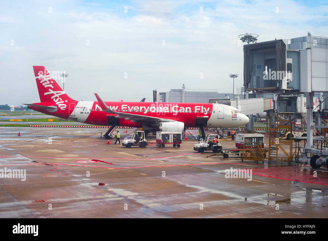 SINGAPORE - FEB 15, 2017: AirAsia aircraft in Changi International Airport during unloading baggage. Changi is the - Stock Image