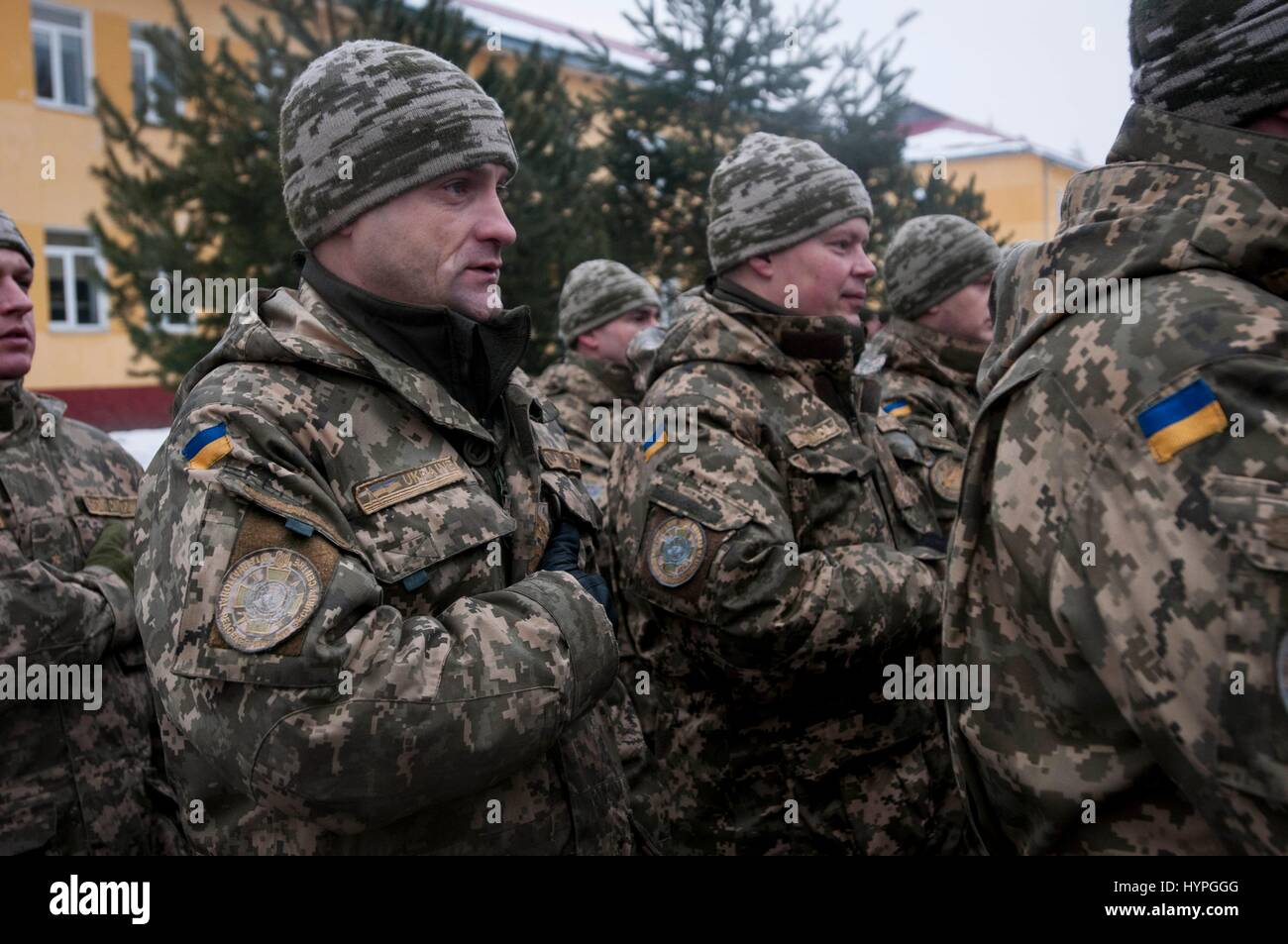 Ukrainian soldiers sing along to the national anthem during an opening ceremony at the International Peacekeeping - Stock Image