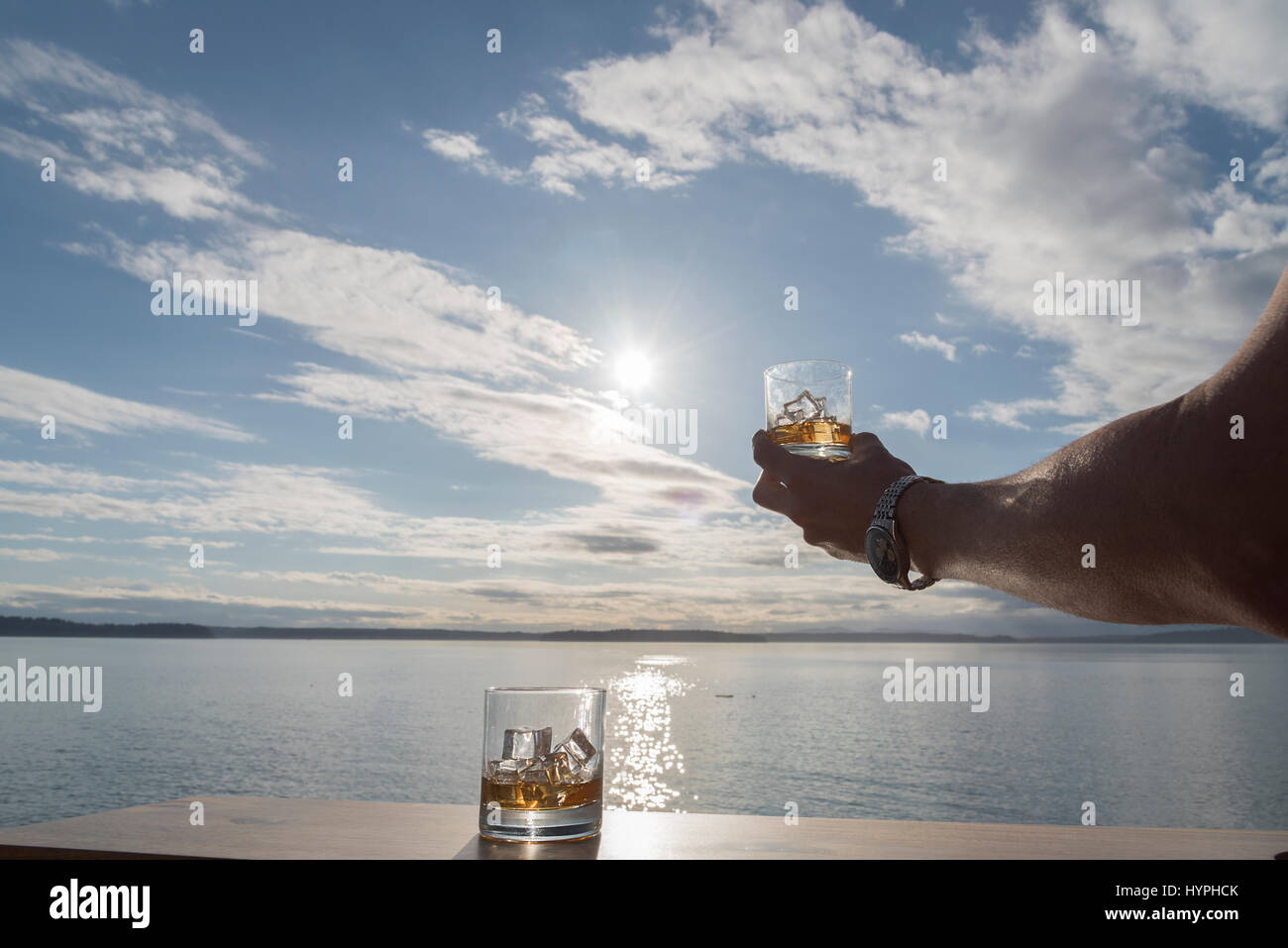 Whiskey in the window with binoculars - Stock Image
