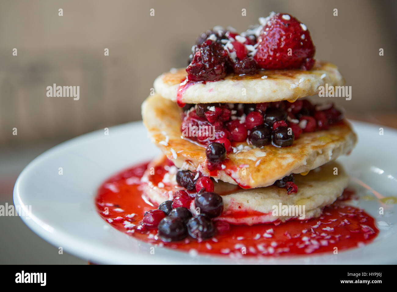 Raspberry and blueberry pancake stack - Stock Image