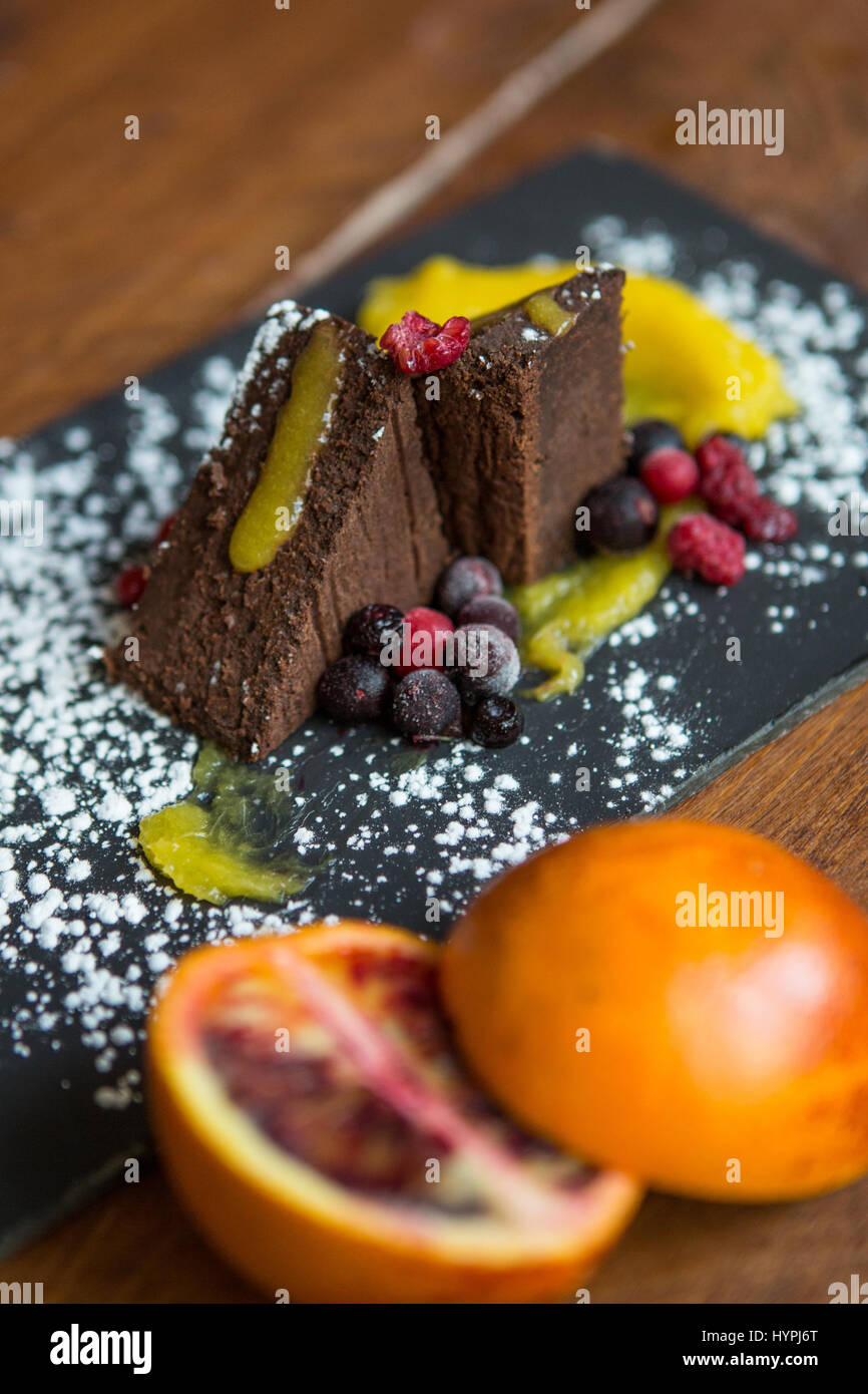 Chocolate brownies decorated with berries - Stock Image
