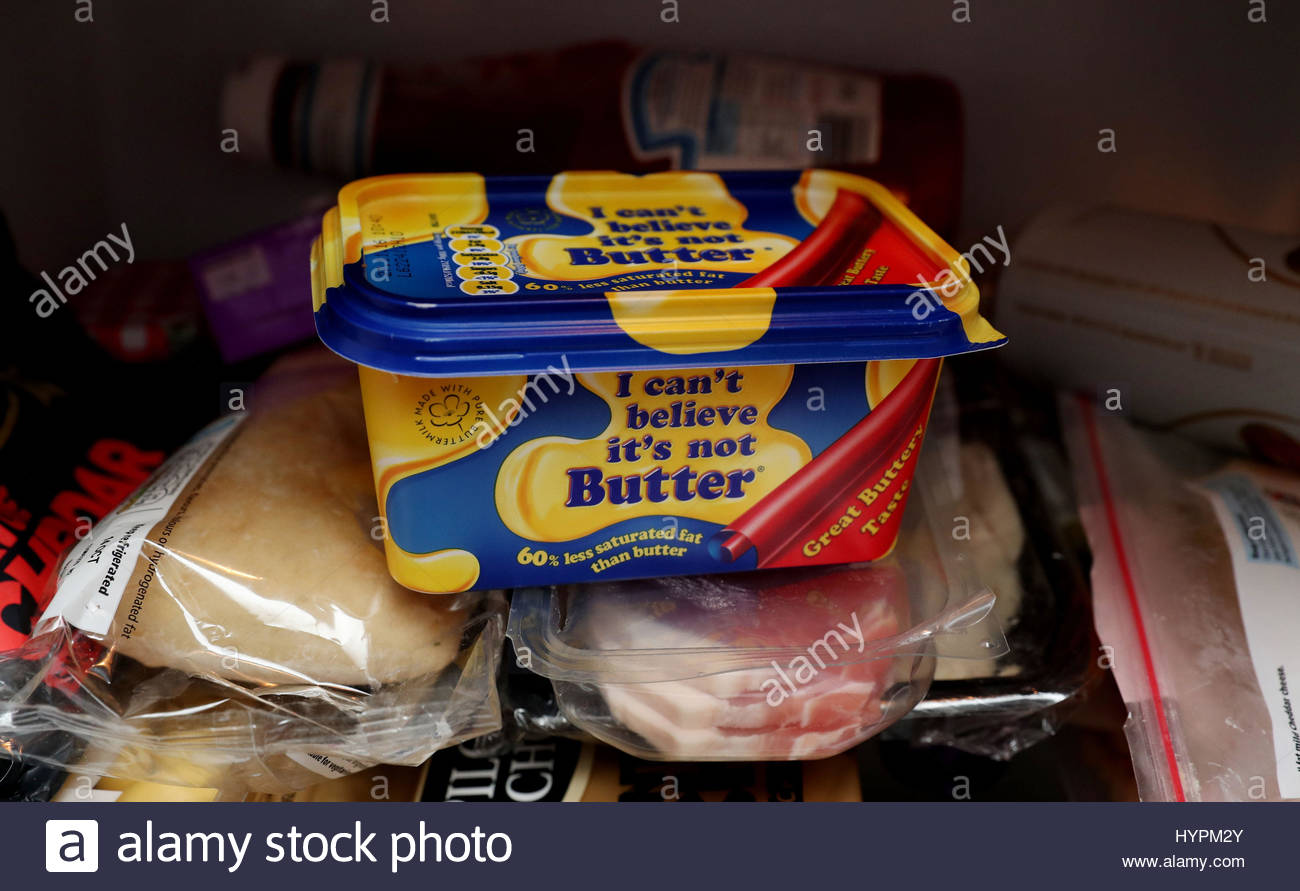 File photo dated 13/10/16 of a tub of 'I can't believe it's not Butter' in a fridge, as Unilever - Stock Image