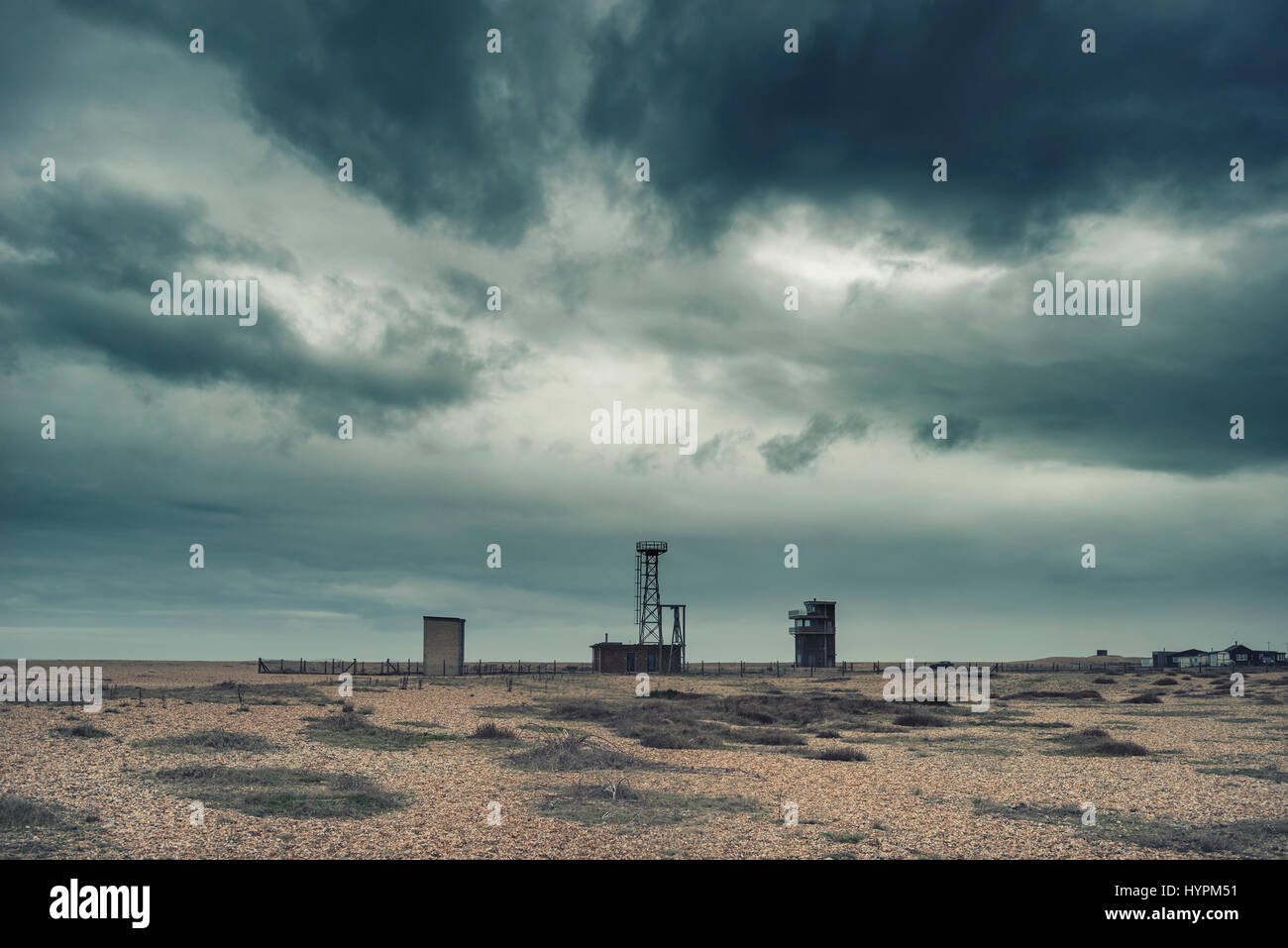 Cross processed conceptual post apocalyptic nuclear landscape with abandoned buildings - Stock Image
