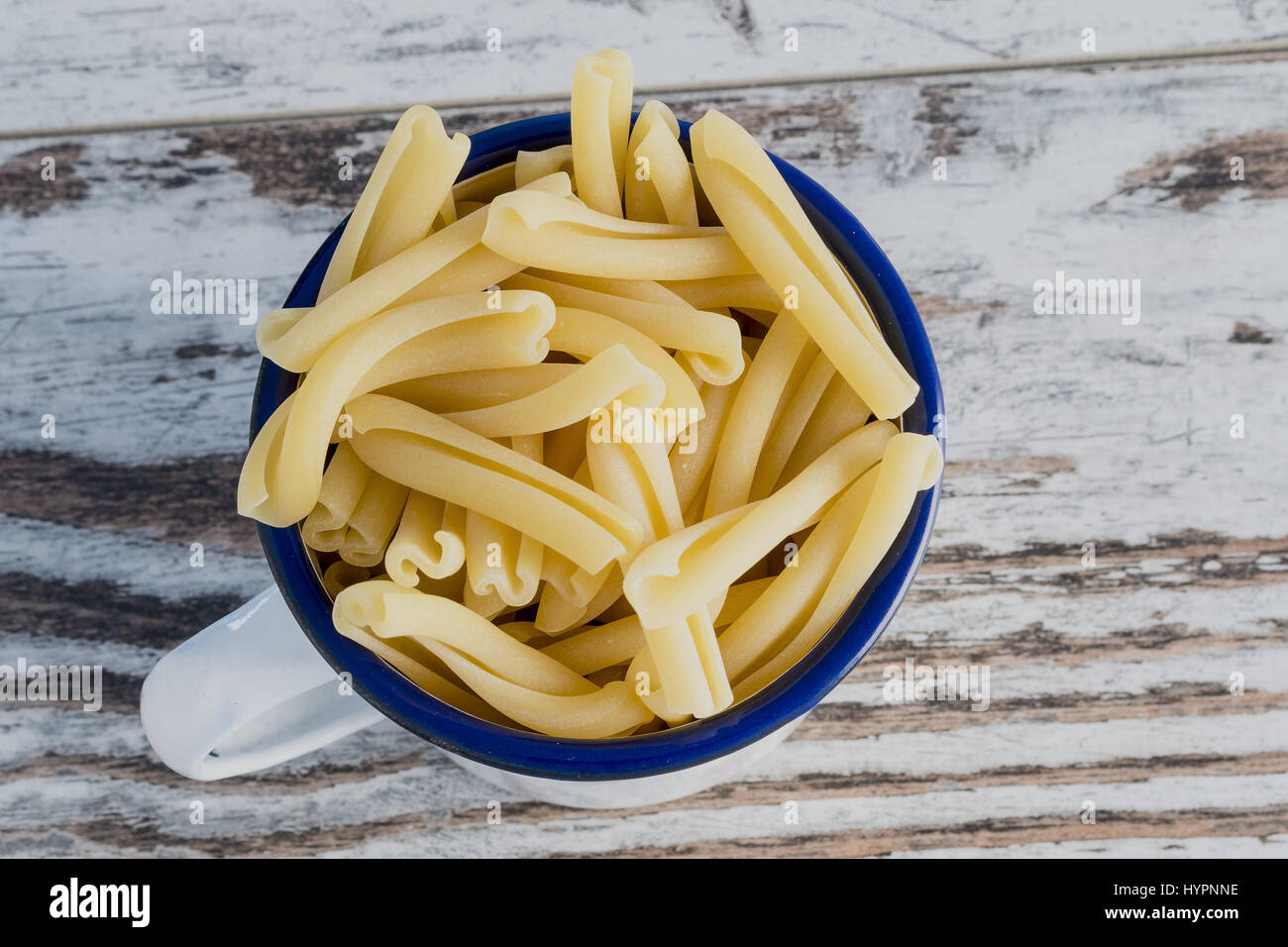 short pasta in metal bowl twins Angle - Stock Image