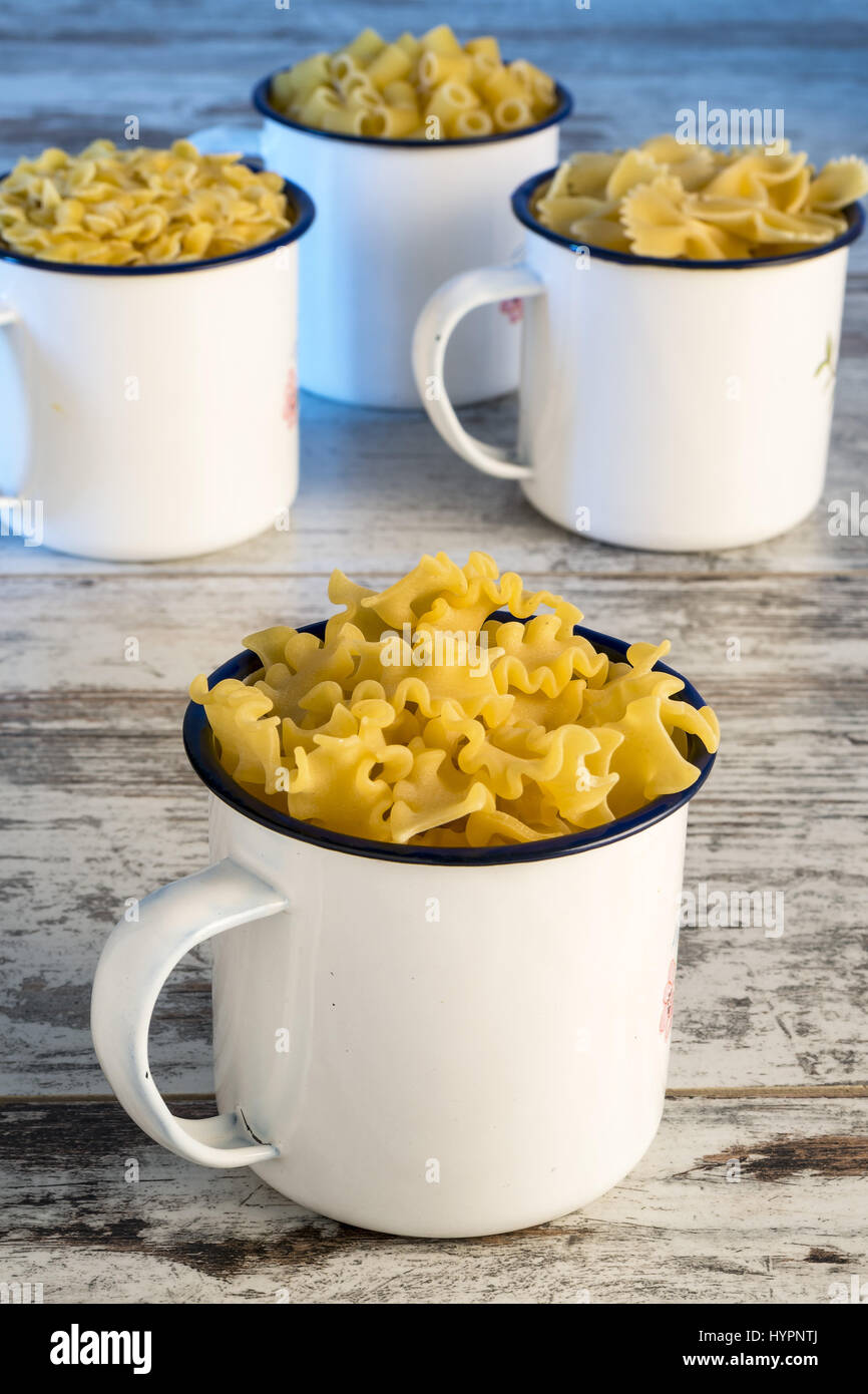 dried pasta in metal cup reginelle front - Stock Image