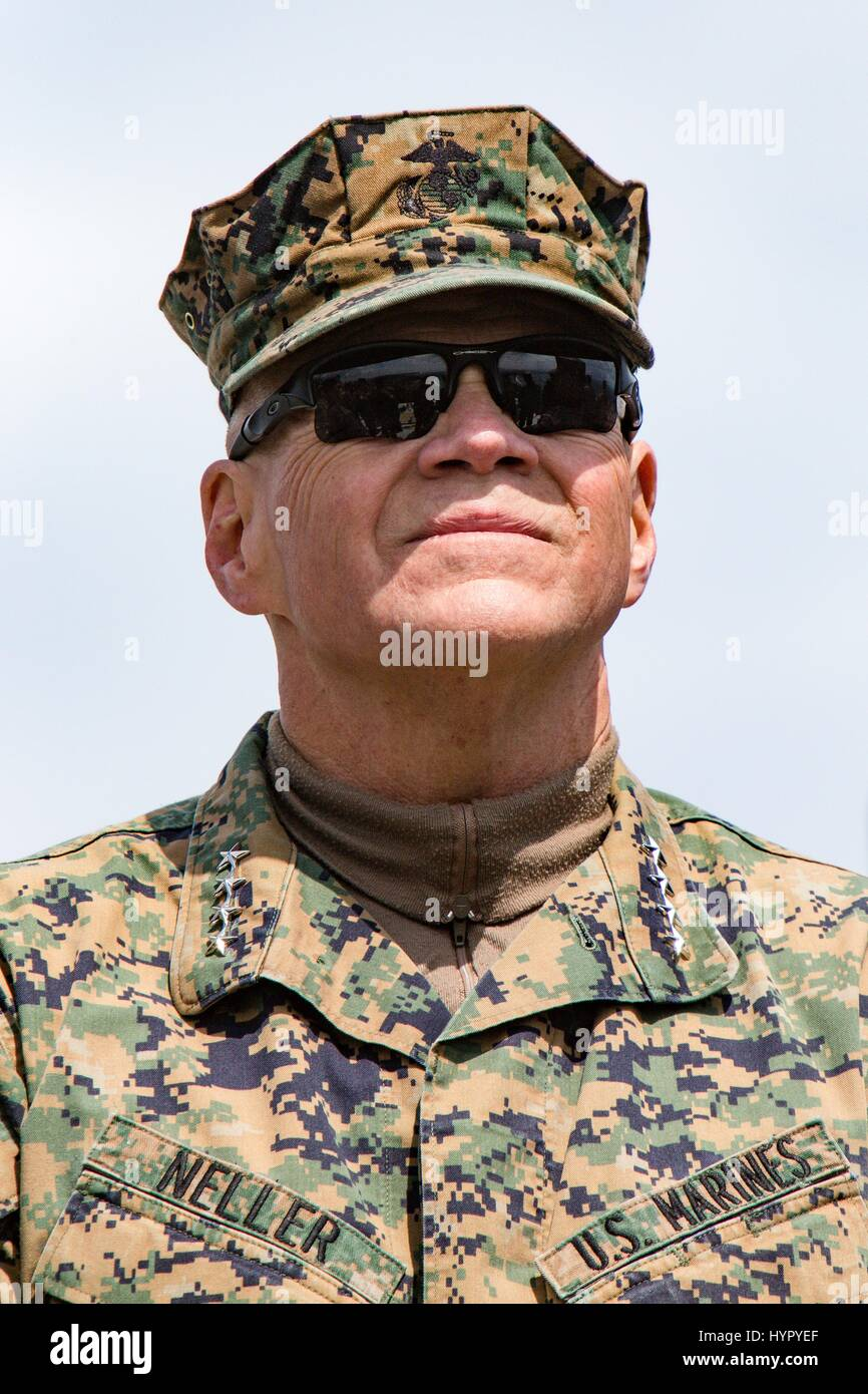 U.S. Marine Corps Commandant Gen. Robert Neller watches an amphibious assault demonstration during at the annual Stock Photo