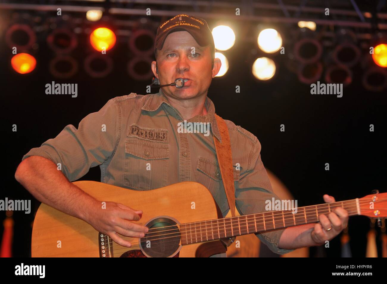 U.S. National Guard soldier and singer Darby Ledbetter performs his country music single I WonÕt Let My Guard - Stock Image