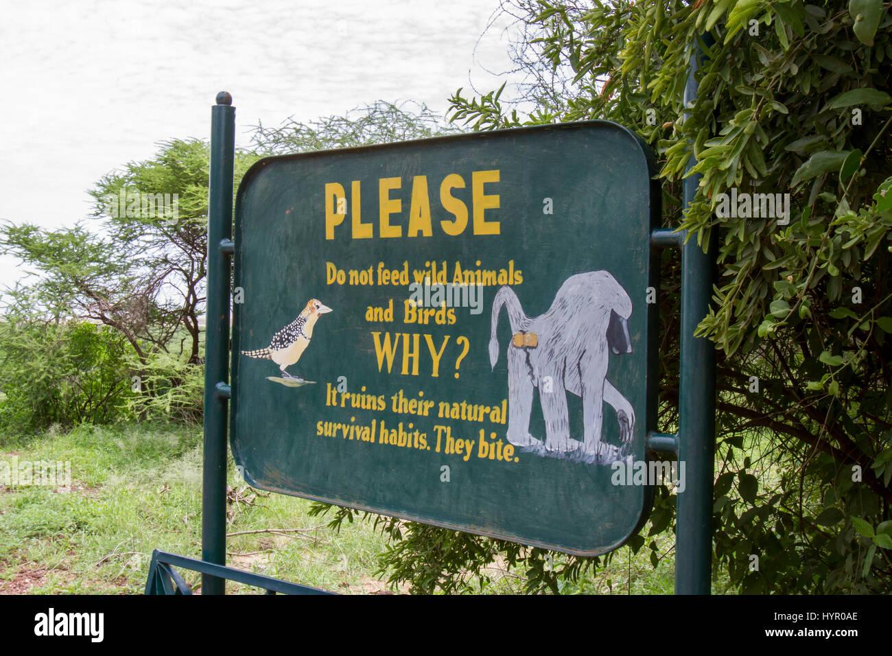 Lake Manyara National Park, Tanzania - March 6, 2017 :  WIldlife interaction feeding warning sign in Lake Manyara - Stock Image