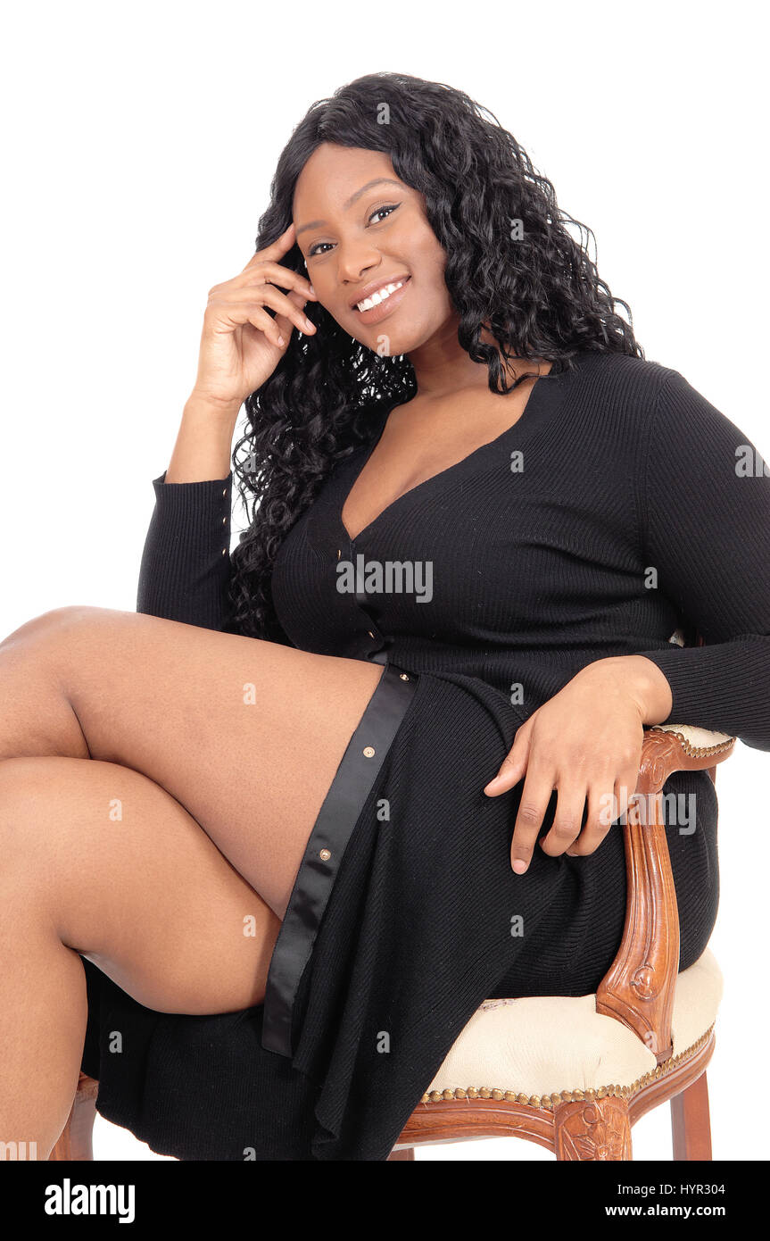 A Beautiful African American Business Woman Sitting In A