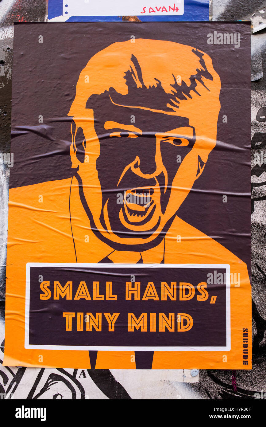 """Poster from artist Subdude with drawing representing Donald Trump shouting and words """"Small hands, tiny mind"""" below Stock Photo"""