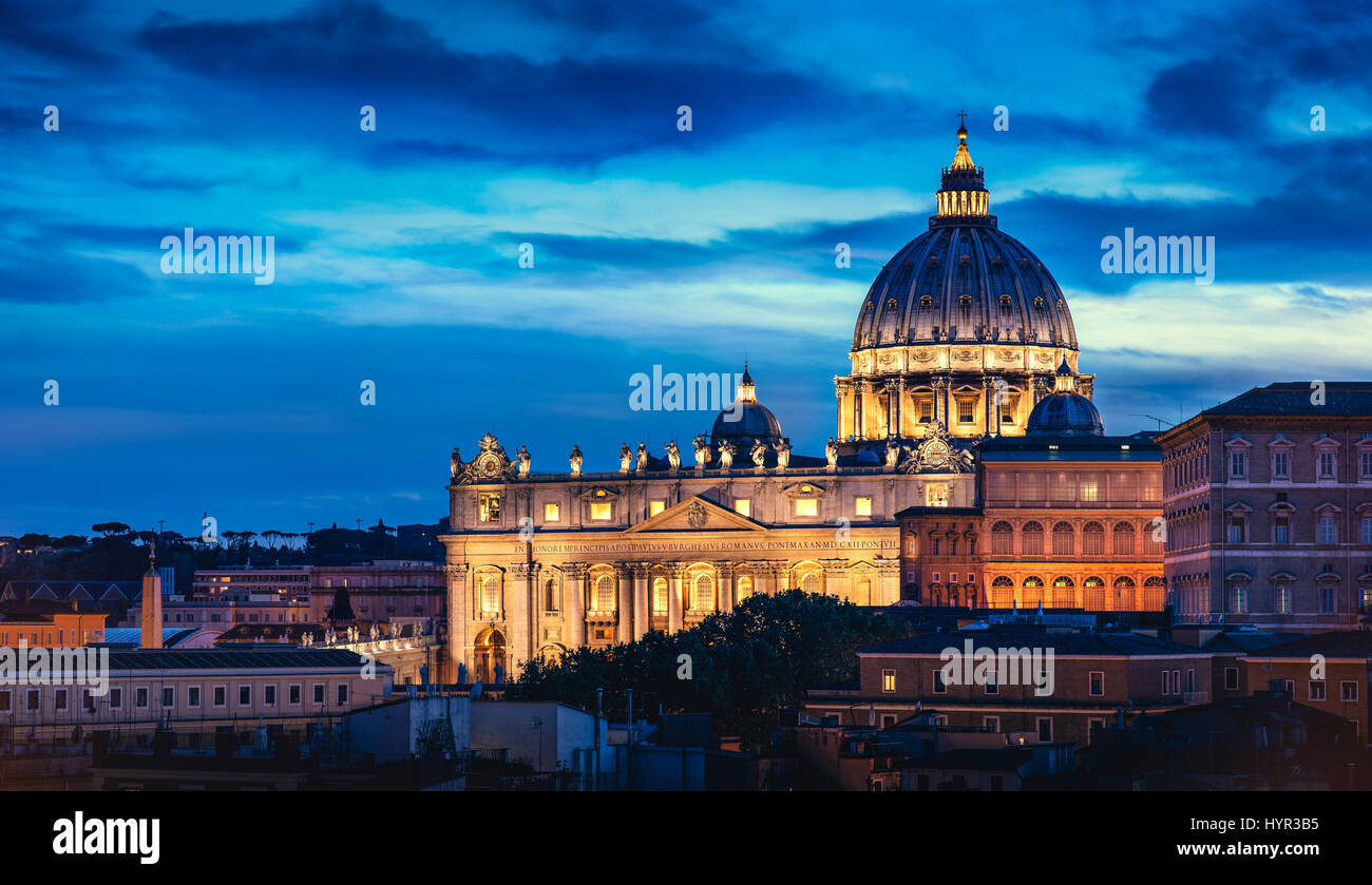St. Peter's Basilica in Vatican City within the city of Rome at dusk. - Stock Image