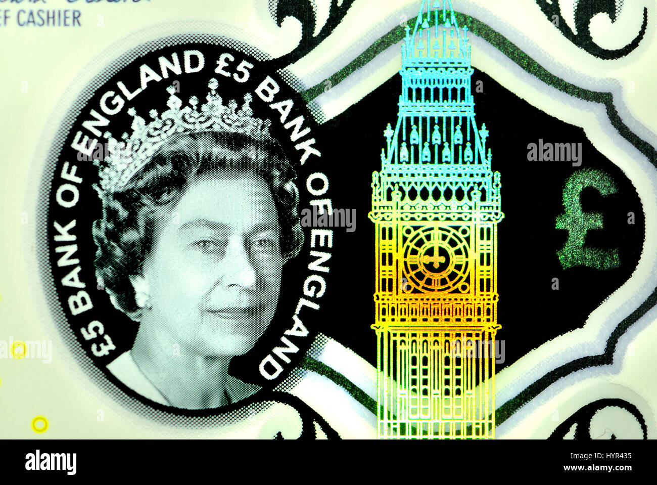 New British polymer £5 note (2016) Security features: transparent 'watermark' and holographic Big Ben - Stock Image