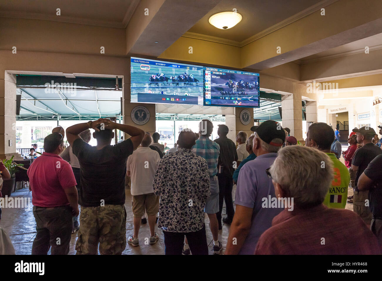 HALLANDALE BEACH, USA - MAR 11, 2017: People betting on horse races in the Gulfstream park casino in Hallandale - Stock Image