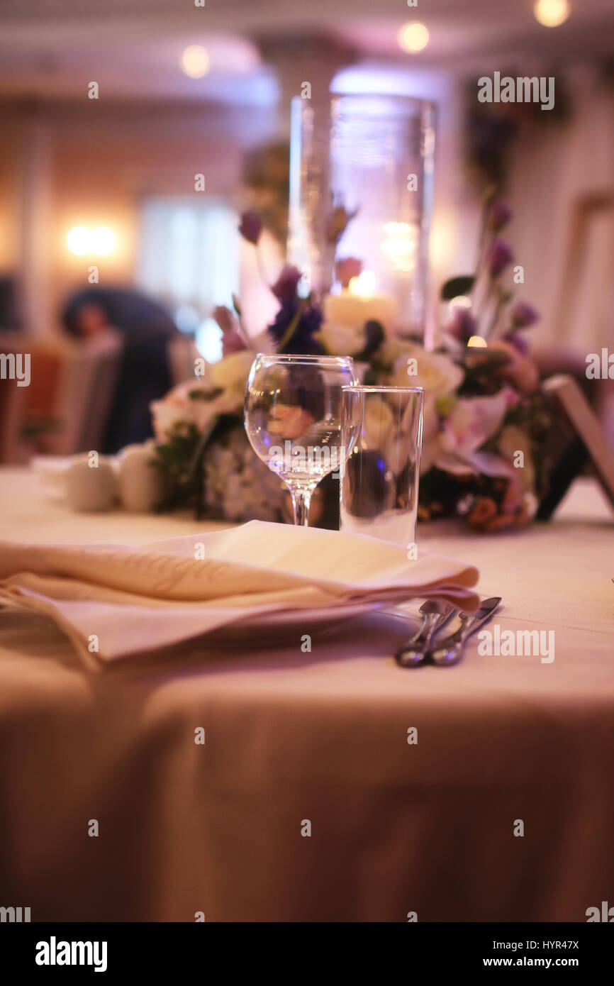 Glass wine glasses on the table served in the restaurant - Stock Image