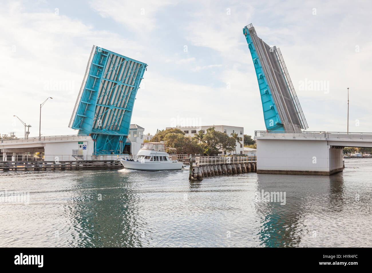 Boat coming through the open drawbridge in Pompano Beach. Florida, United States - Stock Image