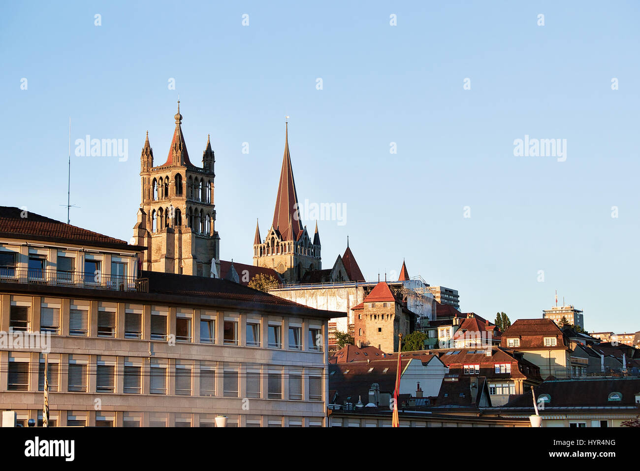 Lausanne Cathedral of Notre Dame in Lausanne city center, Switzerland. Seen from Le Flon district - Stock Image