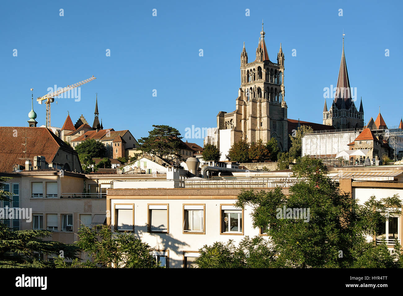 Cathedral of Notre Dame in Lausanne, in Switzerland. Seen from Le Flon district - Stock Image