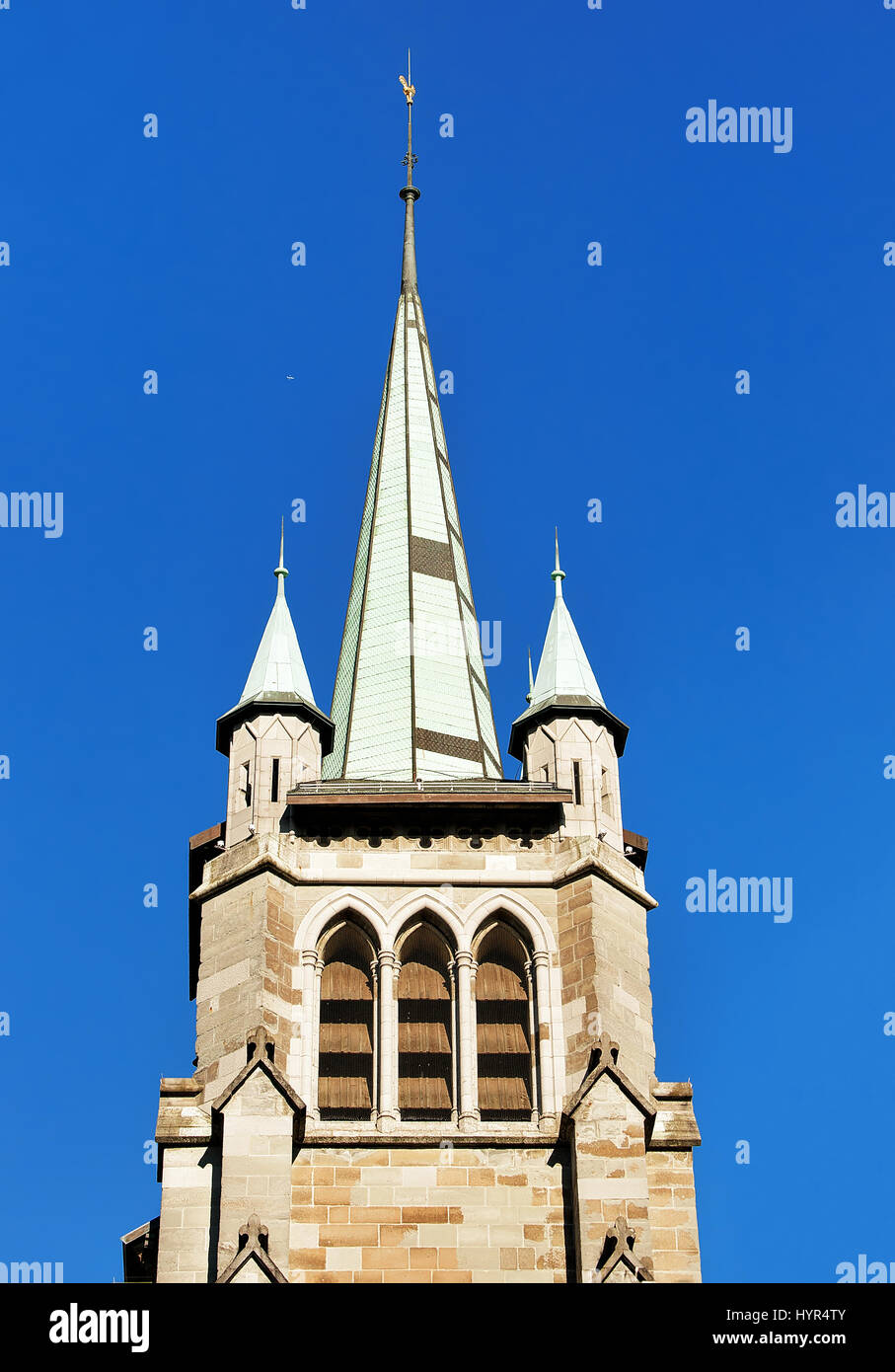 Steeple of St Francois Church in Lausanne, Switzerland. Seen from Le Flon district - Stock Image