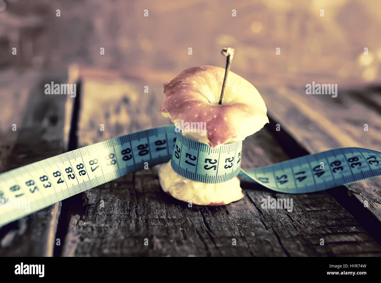 anorexia thinness measuring apple - Stock Image