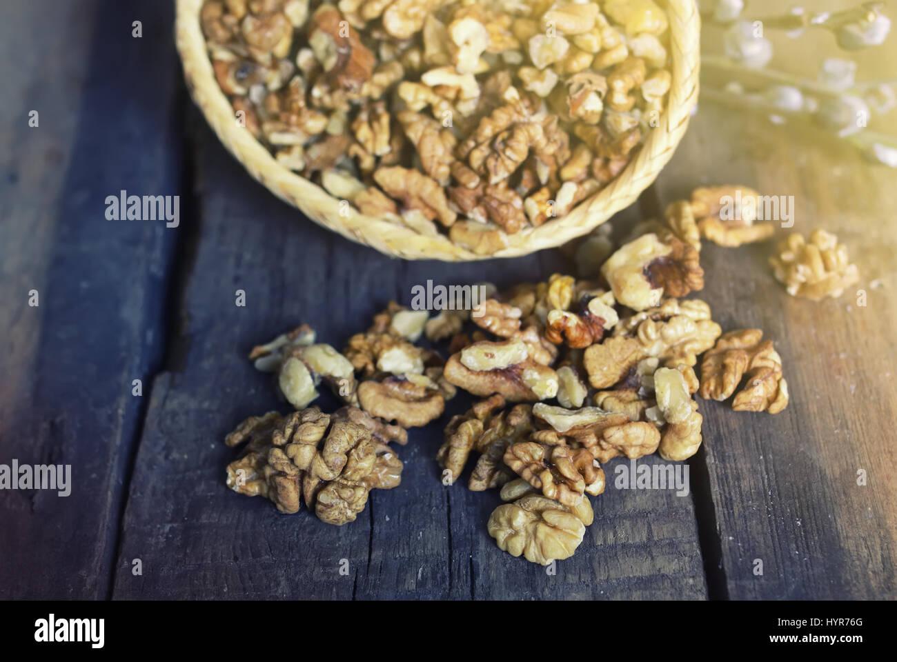 walnut on wooden background - Stock Image