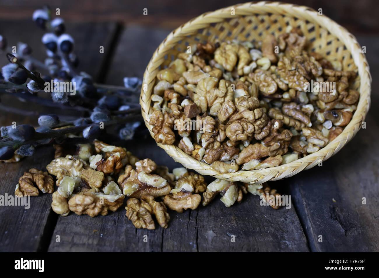 peeled walnut on a wooden background - Stock Image
