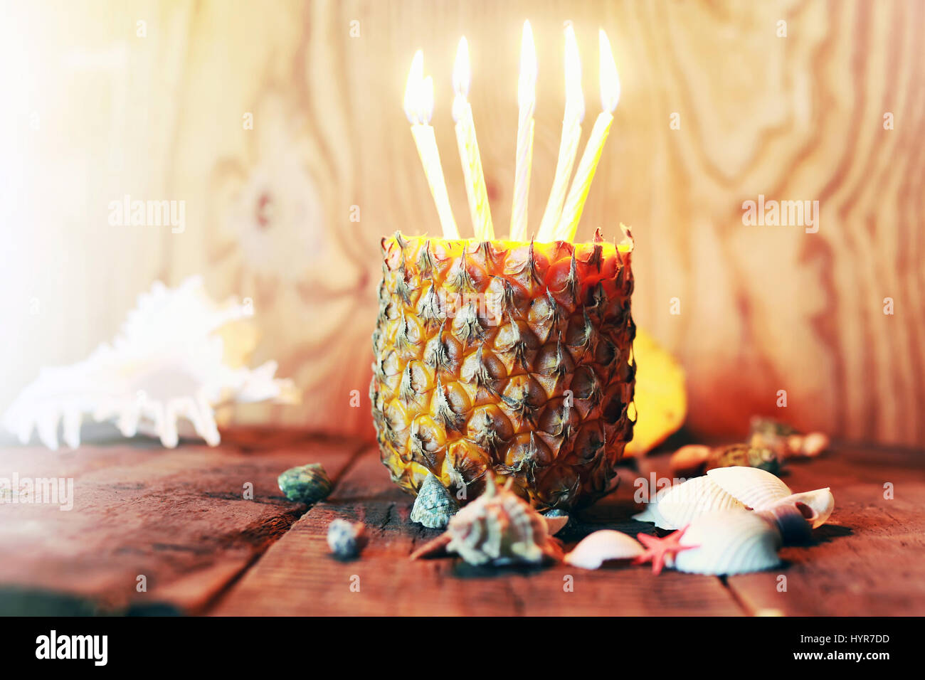 pineapple with candles - Stock Image