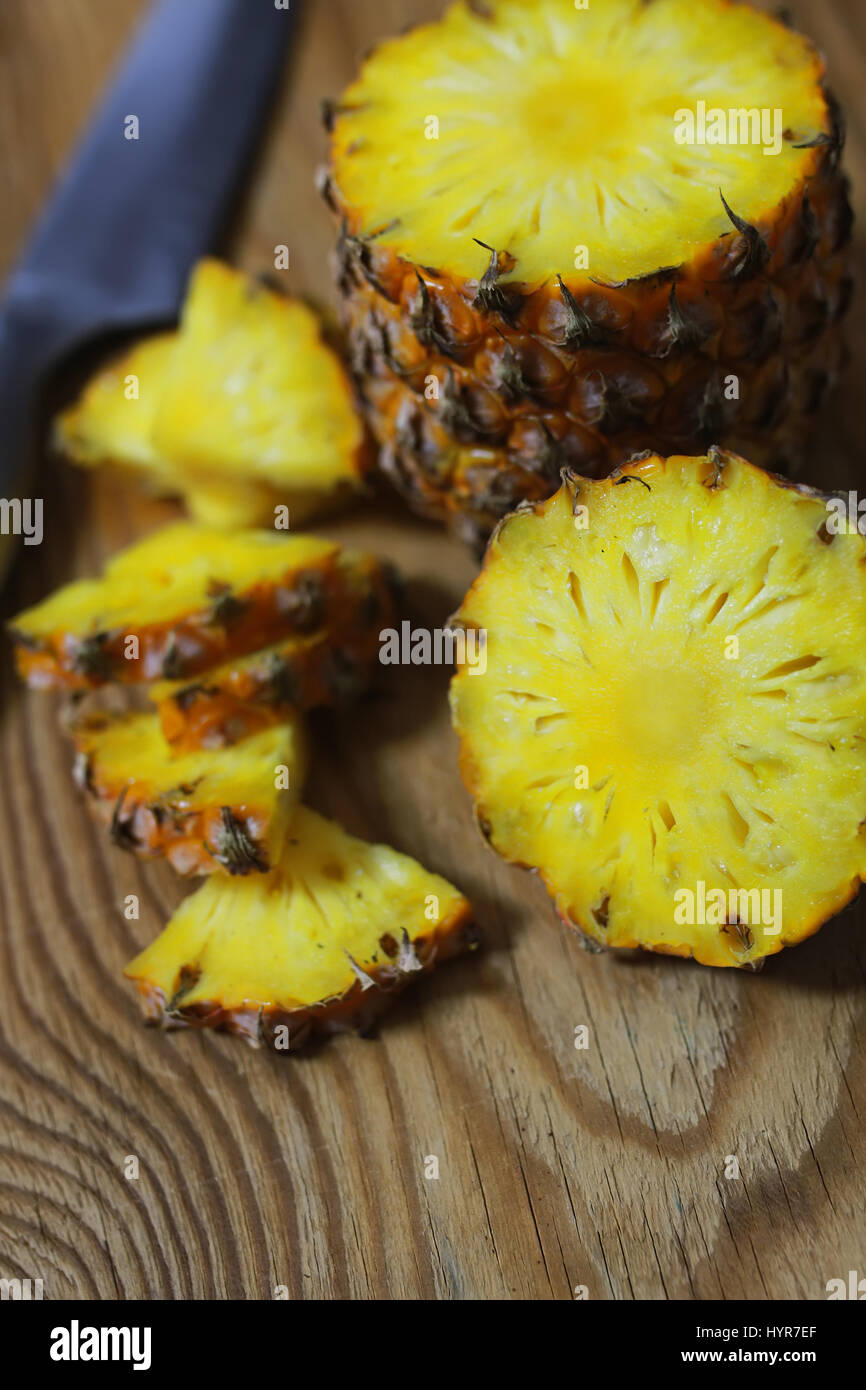 pineapple slices cut knife - Stock Image