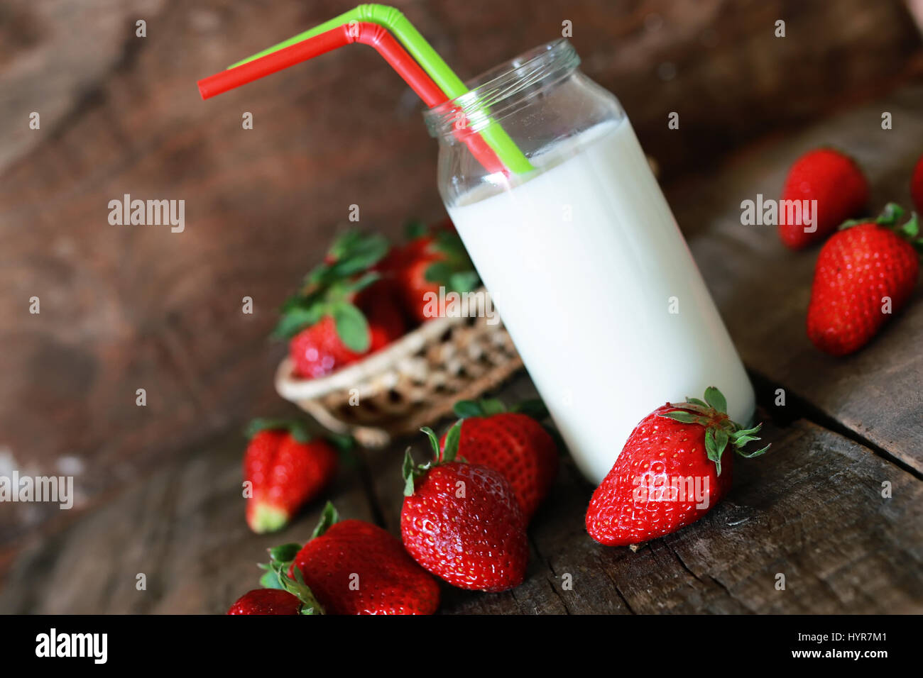 strawberries and milk in a glass Stock Photo