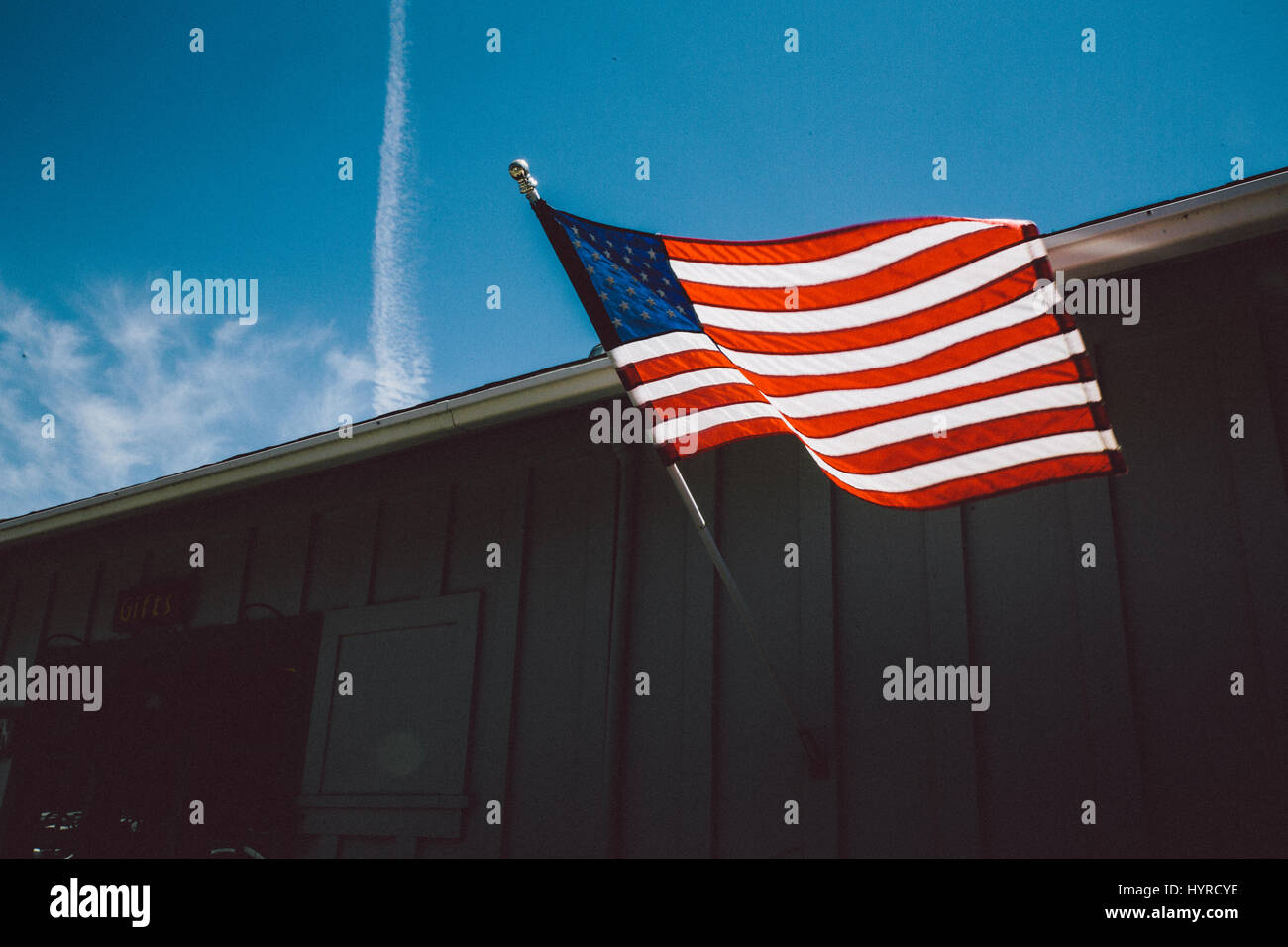 USA Flag Blowing in the Wind - Stock Image