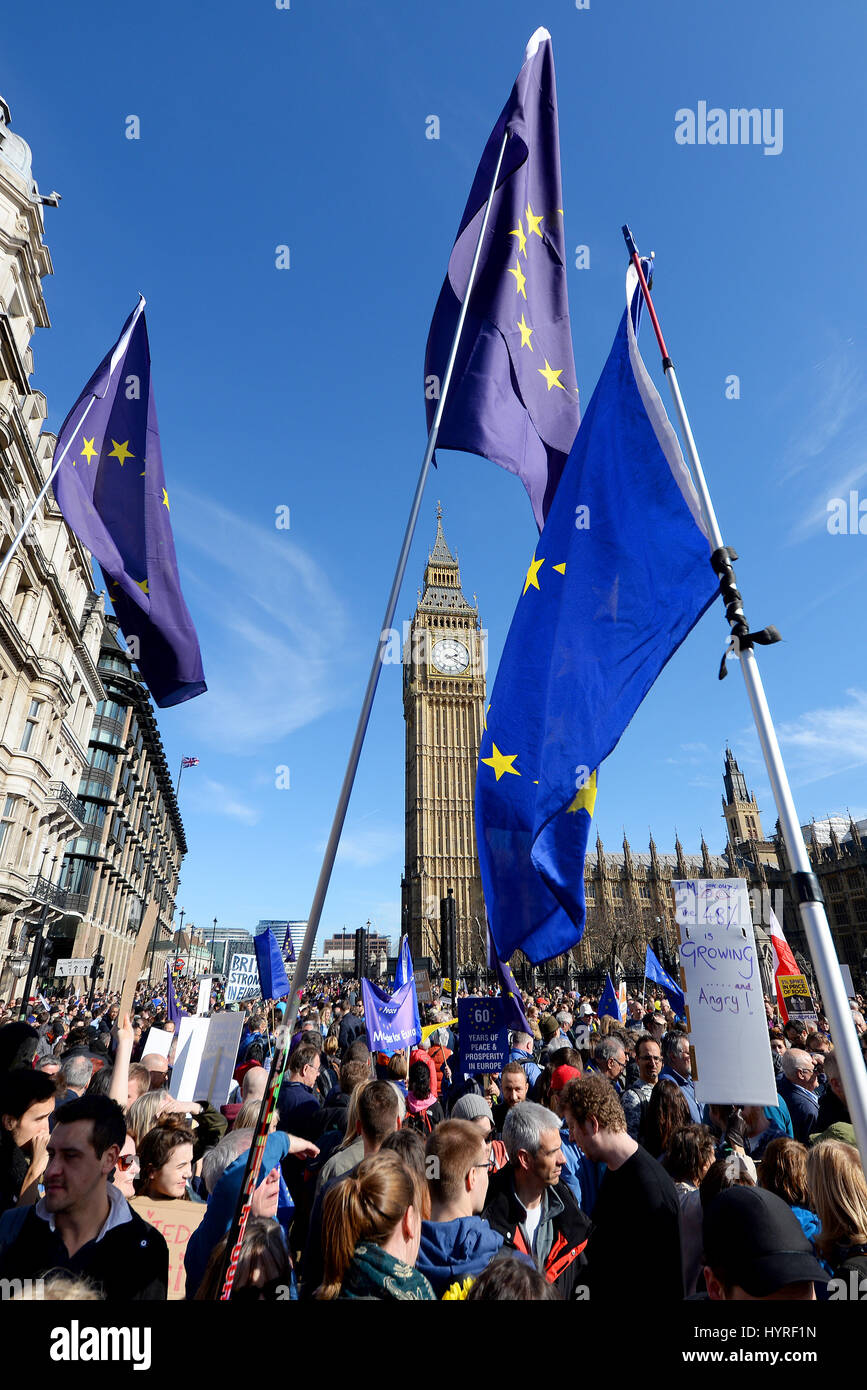 European flags framing Big Ben at the Houses of Parliament in London during a Unite for Europe demonstration after - Stock Image
