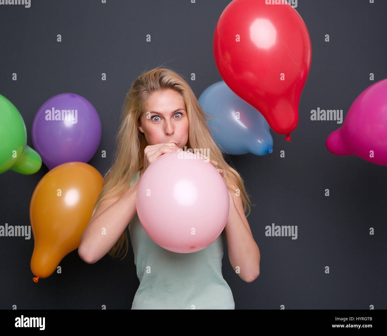 Mature women blow balloon